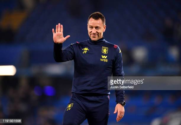 John Terry Assistant Head Coach of Aston Villa acknowledges the fans during the warm up prior to the Premier League match between Chelsea FC and...