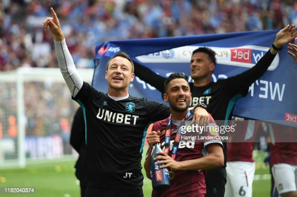 John Terry, Assistant Head Coach of Aston Villa and Neil Taylor of Aston Villa celebrate following their team's victory in the Sky Bet Championship...