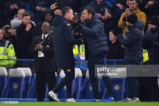 John Terry Assistant Head Coach of Aston Villa embraces Frank Lampard Manager of Chelsea after the Premier League match between Chelsea FC and Aston...