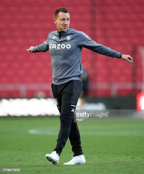 John Terry, Assistant Head Coach of Aston Villa looks on prior to the Carabao Cup third round match between Bristol City and Aston Villa at Ashton...