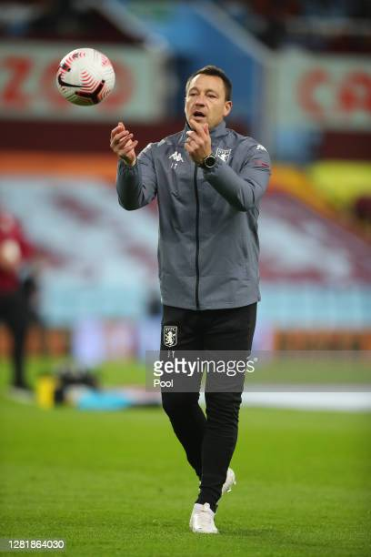 John Terry, Assistant Manager at Aston Villa throws the ball during the warm up prior to the Premier League match between Aston Villa and Leeds...