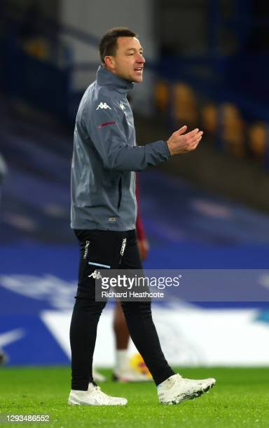 John Terry, assistant manager of Aston Villa reacts ahead of the Premier League match between Chelsea and Aston Villa at Stamford Bridge on December...