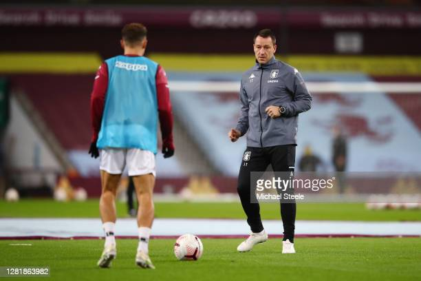 John Terry, Assistant Manager of Aston Villa warms up with one of his players prior to the Premier League match between Aston Villa and Leeds United...
