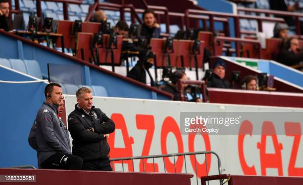 John Terry, Aston Villa Assistant Coach speaks with Dean Smith, Manager of Aston Villa as the look on during the Premier League match between Aston...