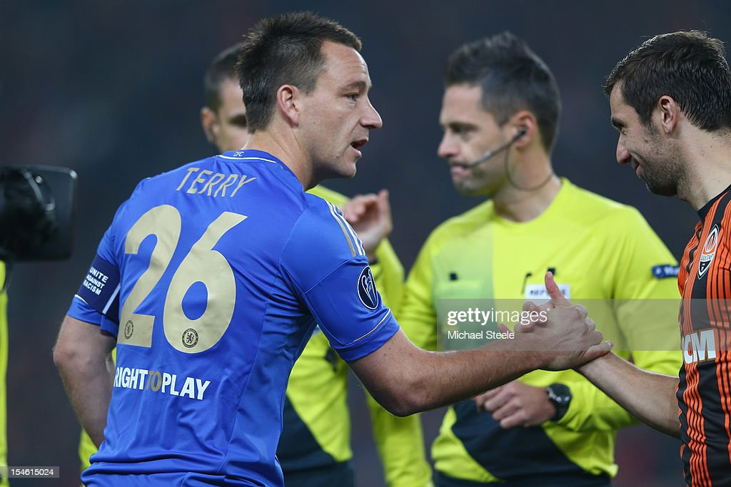 John Terry (L) captain of Chelsea shakes hands with Darijo Srna (R) captain of Shakhtar Donetsk during the UEFA Champions League Group E match between Shakhtar Donetsk and Chelsea at the Donbass Arena on October 23, 2012 in Donetsk, Ukraine.