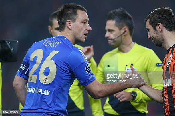 John Terry captain of Chelsea shakes hands with Darijo Srna captain of Shakhtar Donetsk during the UEFA Champions League Group E match between...