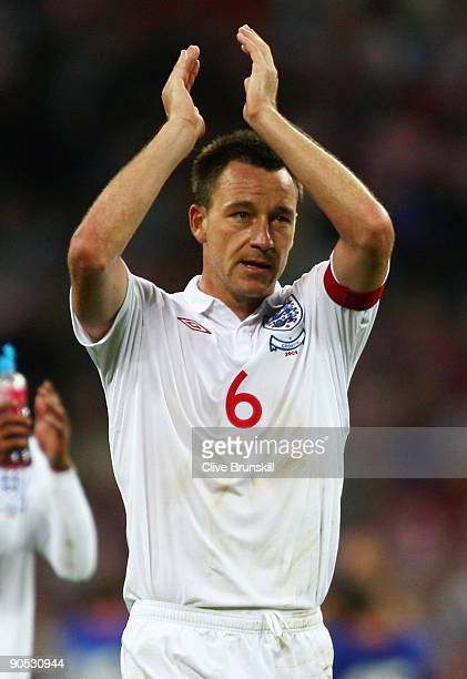 John Terry captain of England applauds the fans at the end of the FIFA 2010 World Cup Group 6 Qualifying match between England and Croatia at Wembley...