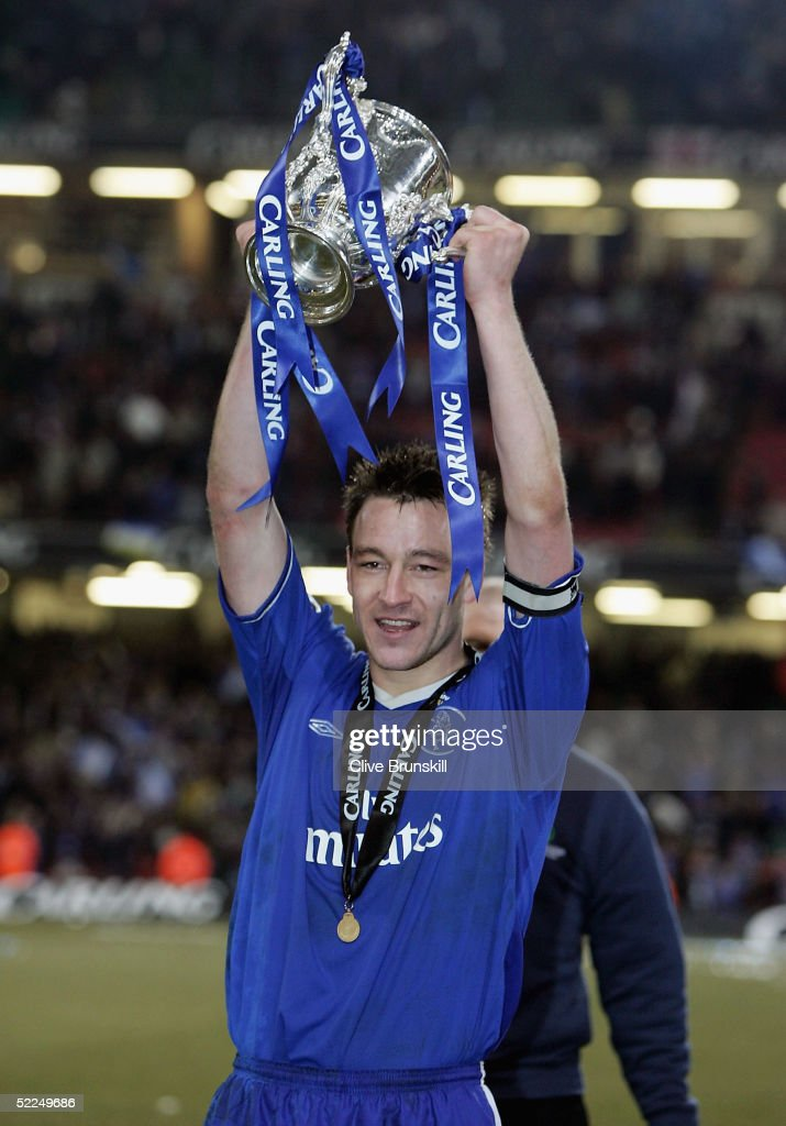 John Terry celebrates with the Carling Cup trophy at the end of the Carling Cup Final match between Chelsea and Liverpool at the Millennium Stadium on February 27, 2005 in Cardiff, Wales.