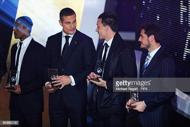 John Terry chats with Nemanja Vidic as Patrice Evra and Iker Casillas look on after collecting their FIFA World XI Player Awards during the FIFA...