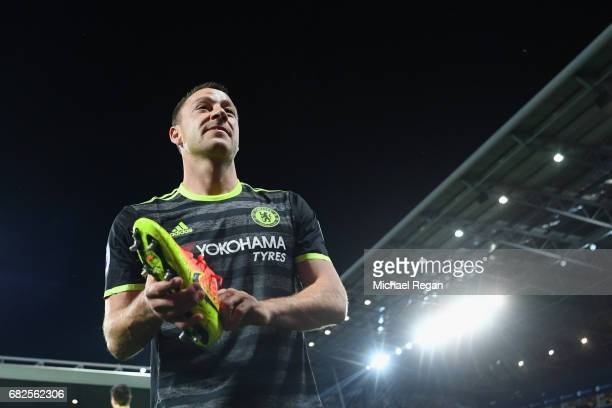John Terry looks on as Chelsea celebrate winning the league after the Premier League match between West Bromwich Albion and Chelsea at The Hawthorns...