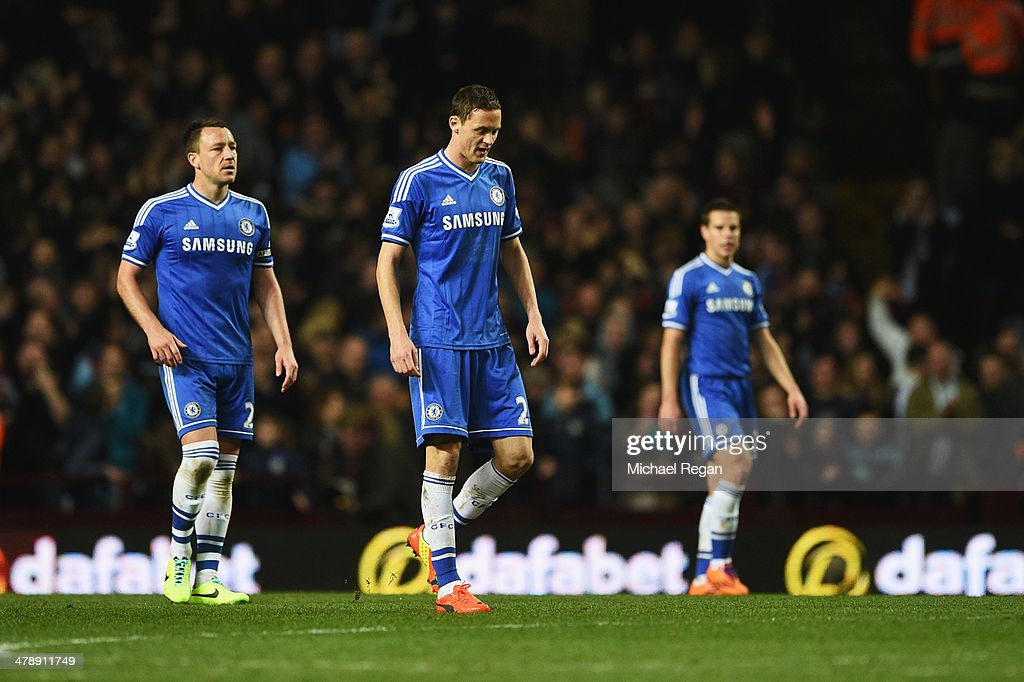 John Terry, Nemanja Matic and Cesar Azpilicueta of Chelsea look dejected as Fabian Delph of Aston Villa (not pictured) scores the first goal during the Barclays Premier League match between Aston Villa and Chelsea at Villa Park on March 15, 2014 in Birmingham, England.