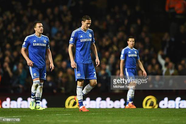 John Terry Nemanja Matic and Cesar Azpilicueta of Chelsea look dejected as Fabian Delph of Aston Villa scores the first goal during the Barclays...