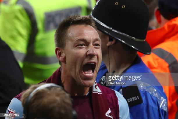 John Terry of Aston Villa celebrates at the full time whistle during the pitch invasion during the Sky Bet Championship Play Off Semi Final second...