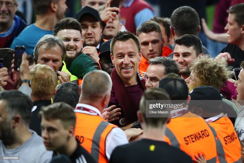 John Terry of Aston Villa celebrates at the full time whistle during the pitch invasion during the Sky Bet Championship Play Off Semi Final second leg match between Aston Villa and Middlesbrough at Villa Park on May 15, 2018 in Birmingham, England.