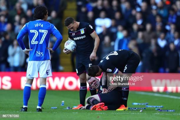 John Terry of Aston Villa checks on teammate Glenn Whelan during the Sky Bet Championship match between Birmingham City and Aston Villa at St Andrews...