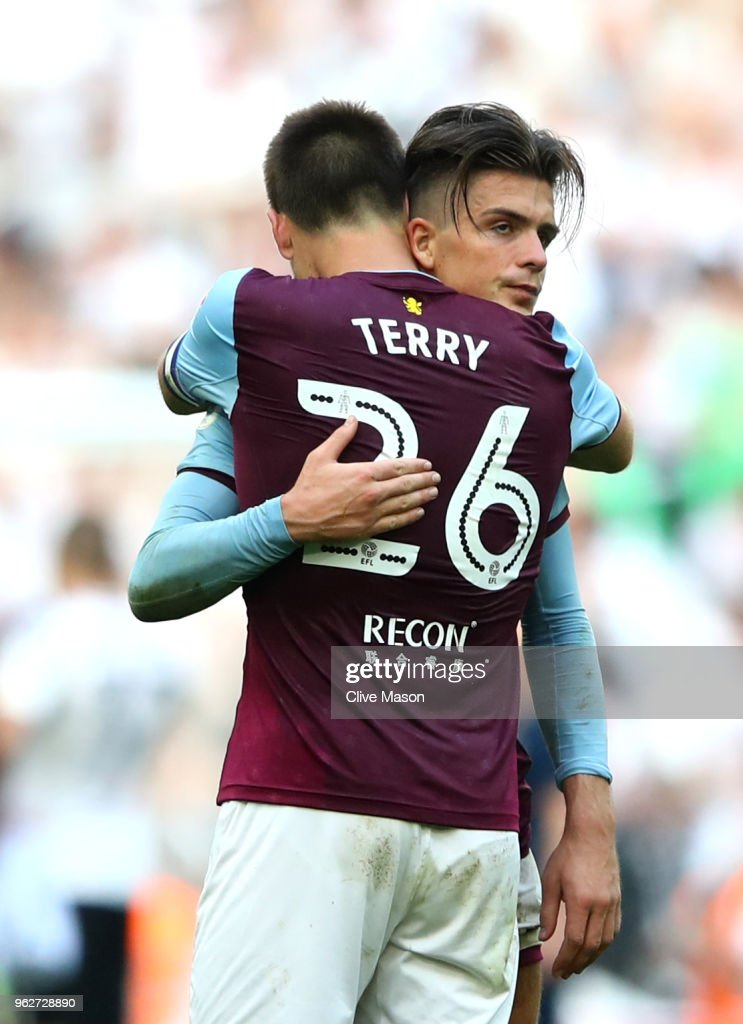 John Terry of Aston Villa consoles Jack Grealish of Aston Villa after their sides defeat in the Sky Bet Championship Play Off Final between Aston Villa and Fulham at Wembley Stadium on May 26, 2018 in London, England.