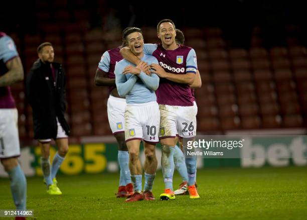 John Terry of Aston Villa shares a joke with team mate Jack Grealish after the Sky Bet Championship match between Sheffield United and Aston Villa at...