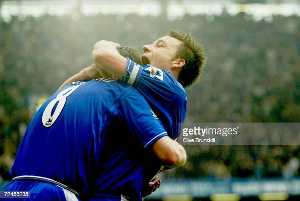 John Terry of Chelea congratulates team mate Frank Lampard after scoring his first goal during the FA Barclaycard Premiership match between Chelsea...