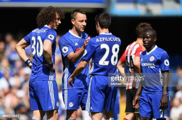 John Terry of Chelsea and Cesar Azpilicueta of Chelsea embrace during the Premier League match between Chelsea and Sunderland at Stamford Bridge on...