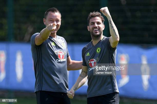 John Terry of Chelsea and Cesc Fabregas of Chelsea gesture during a Chelsea training session at Chelsea Training Ground on May 24 2017 in Cobham...