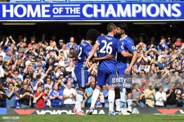 John Terry of Chelsea and Diego Costa of Chelsea embrace as he is subbed during the Premier League match between Chelsea and Sunderland at Stamford...