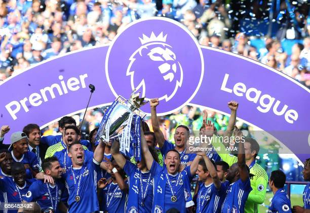 John Terry of Chelsea and his team mates celebrate with the Premier League trophy during the Premier League match between Chelsea and Sunderland at...