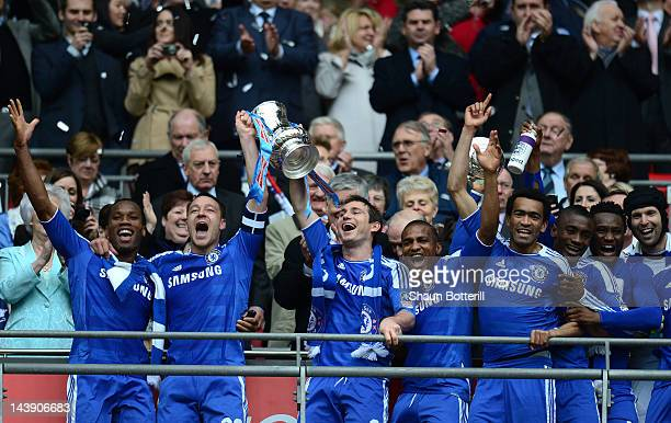 John Terry of Chelsea and his team mates lift the FA Cup trophy during the FA Cup with Budweiser Final match between Liverpool and Chelsea at Wembley...