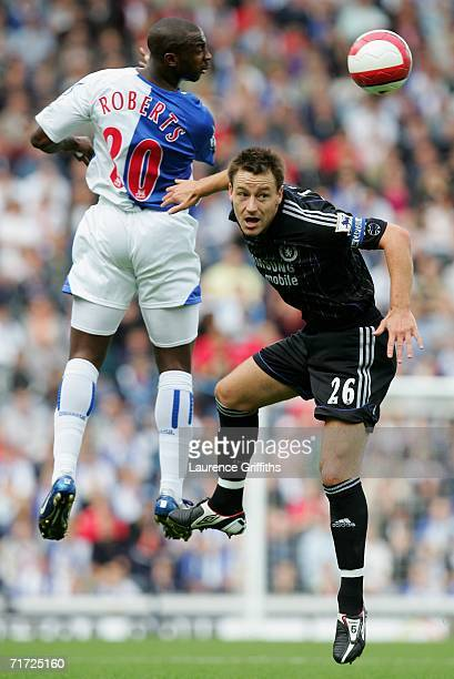 John Terry of Chelsea and Jason Roberts of Blackburn Rovers jump for the ball during the Barclays Premiership match between Blackburn Rovers and...