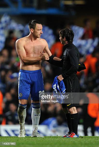 John Terry of Chelsea and Lionel Messi of Barcelona exchange shirts following the final whistle during the UEFA Champions League Semi Final first leg...