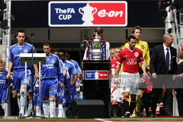 John Terry of Chelsea and Ryan Giggs of Manchester United lead out their teams prior to the FA Cup Final match sponsored by E.ON between Manchester...