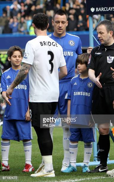 John Terry of Chelsea and Wayne Bridge of Manchester City walk past each other prior to the Barclays Premier League match between Chelsea and...