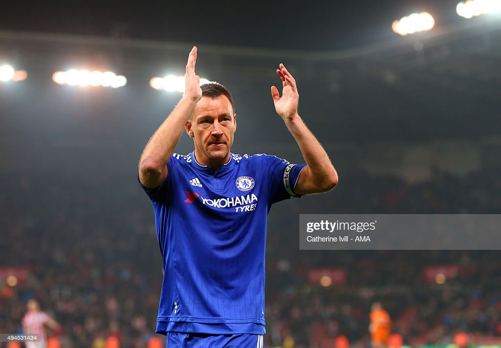 John Terry of Chelsea applauds after the Capital One Cup Fourth Round match between Stoke City and Chelsea at Britannia Stadium on October 27, 2015 in Stoke on Trent, England.