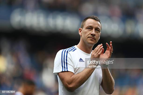 John Terry of Chelsea applauds supporters after the Barclays Premier League match between Chelsea and Leicester City at Stamford Bridge on May 15...