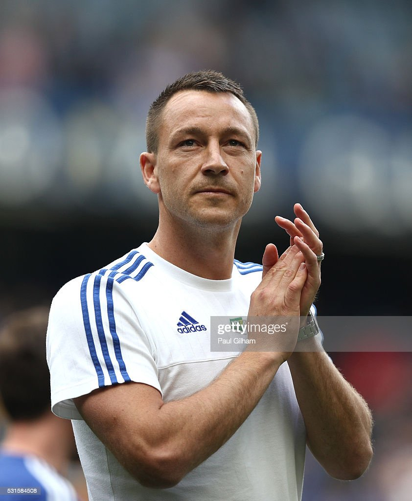 John Terry of Chelsea applauds supporters after the Barclays Premier League match between Chelsea and Leicester City at Stamford Bridge on May 15, 2016 in London, England.