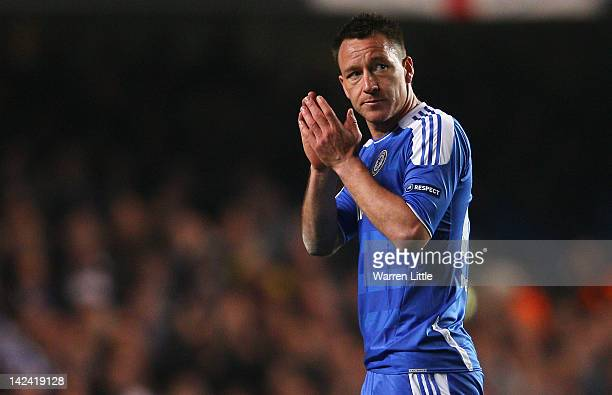 John Terry of Chelsea applauds the fans as he leaves the field during the UEFA Champions League Quarter Final second leg match between Chelsea and...