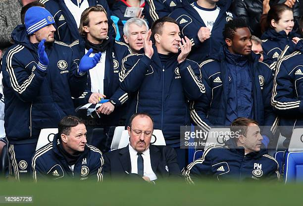 John Terry of Chelsea applauds the opening Chelsea goal as Rafael Benitez interim manager of Chelsea makes notes during the Barclays Premier League...