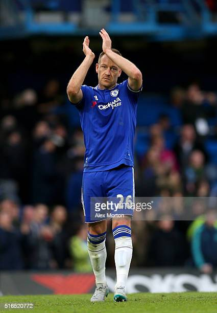 John Terry of Chelsea applauds the supporters after his team's 22 draw in the Barclays Premier League match between Chelsea and West Ham United at...