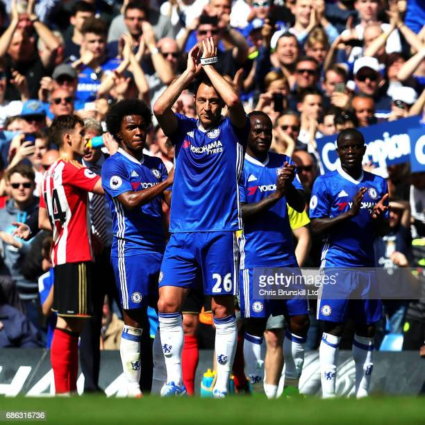 John Terry of Chelsea applauds the supporters as he leaves the field after being substituted during the Premier League match between Chelsea and...