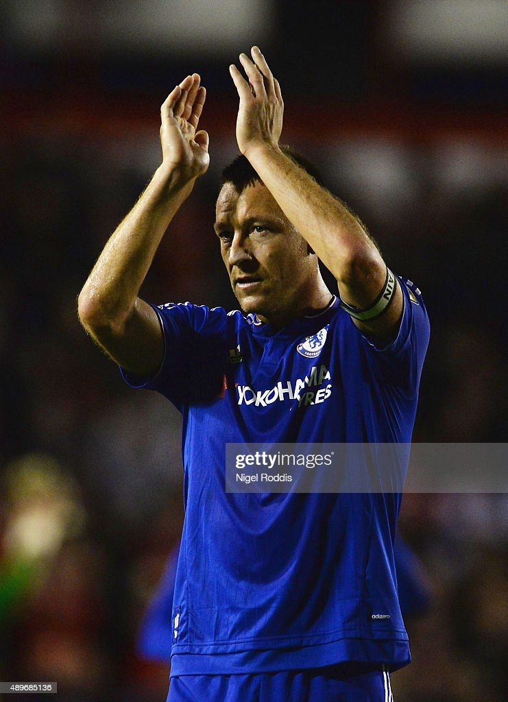 John Terry of Chelsea applauds the travelling fans during the Capital One Cup third round match between Walsall and Chelsea at Banks's Stadium on September 23, 2015 in Walsall, England.