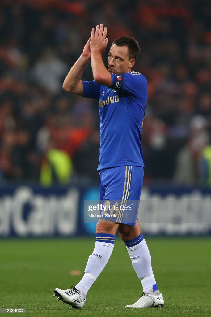 John Terry of Chelsea applauds the travelling supporters after his sides 1-2 defeat during the UEFA Champions League Group E match between Shakhtar Donetsk and Chelsea at the Donbass Arena on October 23, 2012 in Donetsk, Ukraine.