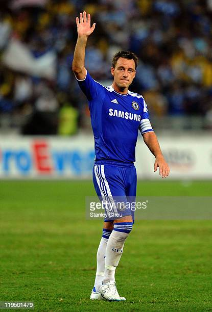 John Terry of Chelsea applauses the fans after Chelsea defeated Malaysia 1-0 during the pre-season friendly match between Malaysia and Chelsea at...