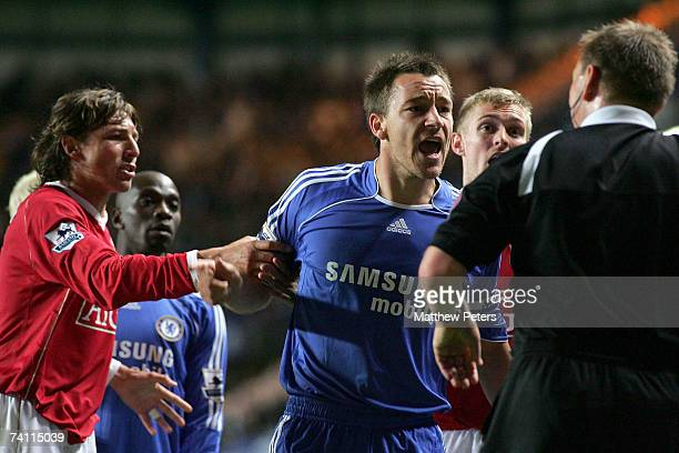 John Terry of Chelsea argues with referee Graham Poll during the Barclays Premiership match between Chelsea and Manchester United at Stamford Bridge...
