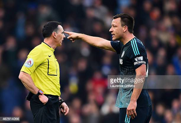 John Terry of Chelsea argues with referee Neil Swarbrick during the Barclays Premier League match between Aston Villa and Chelsea at Villa Park on...