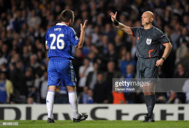 John Terry of Chelsea argues with referee Tom Henning Ovrebo during the UEFA Champions League Semi Final Second Leg match between Chelsea and...