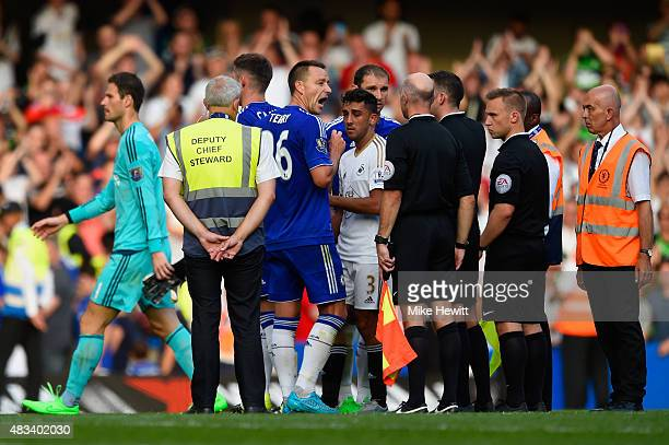 John Terry of Chelsea argues with referees after the 22 draw in the Barclays Premier League match between Chelsea and Swansea City at Stamford Bridge...