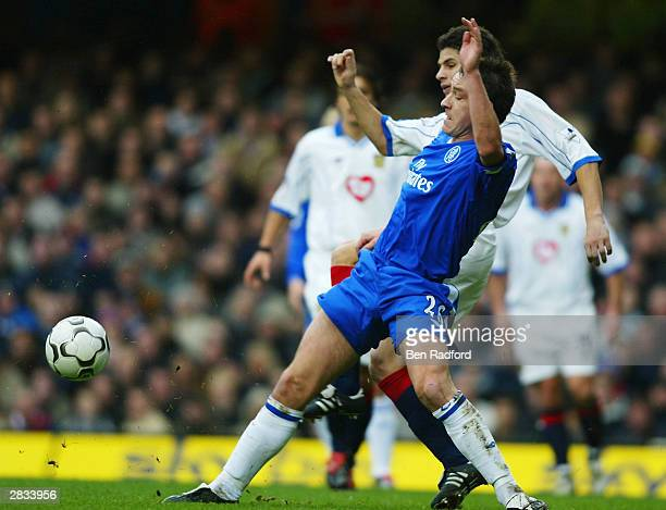 John Terry of Chelsea battles with Dejan Stefanovic of Portsmouth during the FA Barclaycard Premiership match between Chelsea and Portsmouth at...