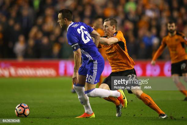 John Terry of Chelsea battles with Jon Dadi Bodvarsson of Wolverhampton Wanderers during the Emirates FA Cup Fifth Round match between Wolverhampton...