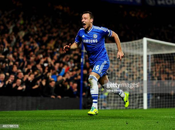 John Terry of Chelsea celebrates as he scores their second goal with a header during the Barclays Premier League match between Chelsea and...