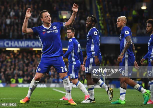John Terry of Chelsea celebrates scoring his sides first goal with his Chelsea team mates during the Premier League match between Chelsea and Watford...