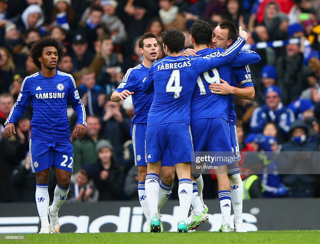John Terry of Chelsea celebrates scoring the opening goal with Diego Costa and Cesc Fabregas of Chelsea during the Barclays Premier League match between Chelsea and West Ham United at Stamford Bridge on December 26, 2014 in London, England.